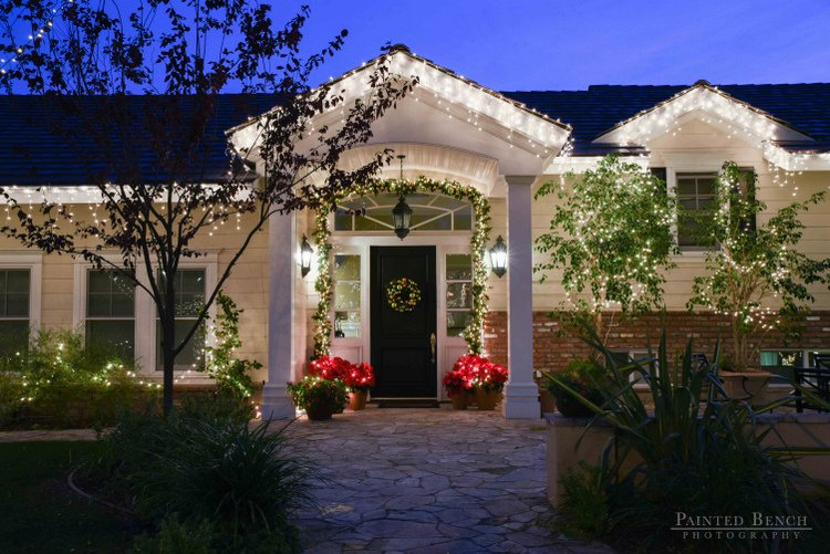classic outdoor Christmas lights on entry to home
