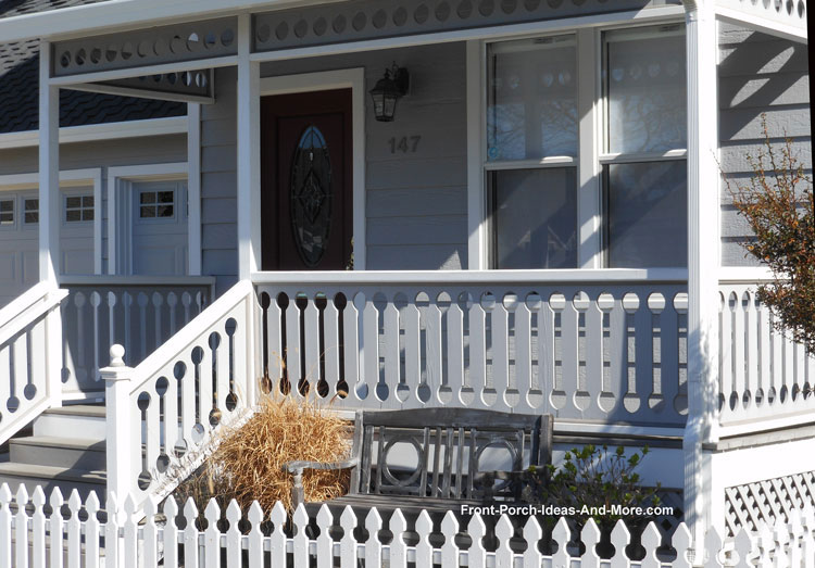 grey sawn wood railings on front porch