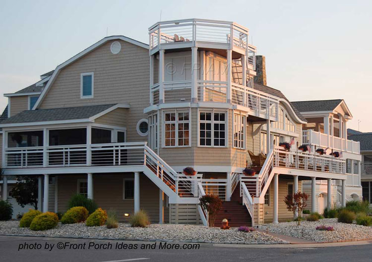 Beach home plans coastal houses front porch pictures for Beach house designs with wrap around porch