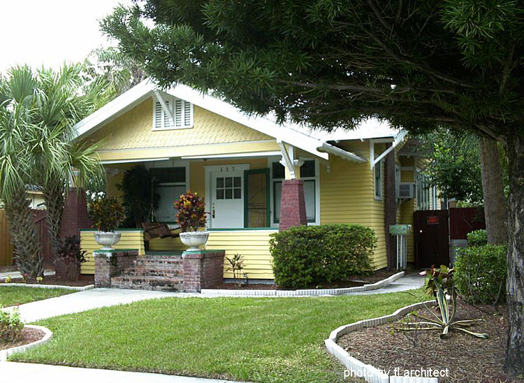 very charming yellow arts and crafts home with nice front porch and knee wall