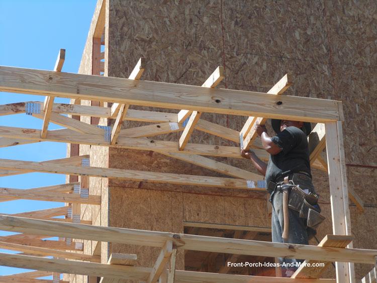 corner trusses installed over wrap around porch
