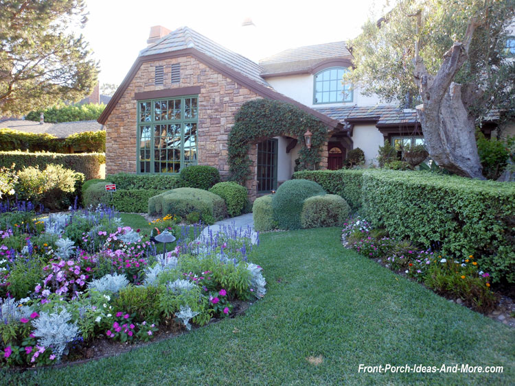 beautiful landscaping and walkway to front porch