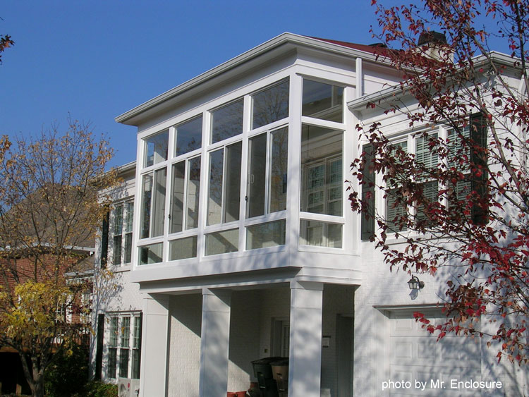 sunroom with floor to ceiling glass panels
