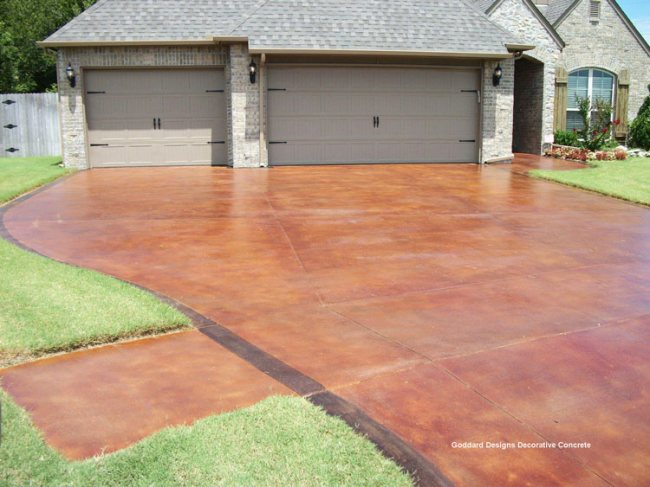 stained driveway leading to home