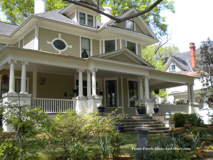 large traditional porch with stone pedestals