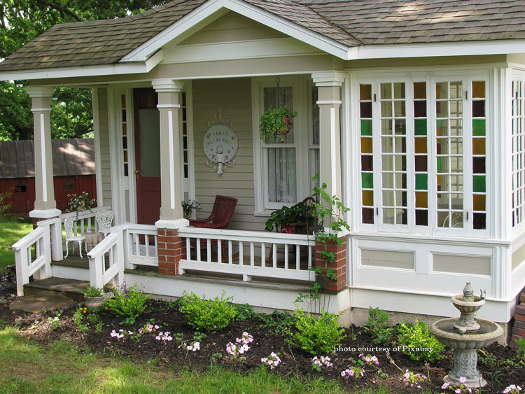 quaint tiny house with charming front porch