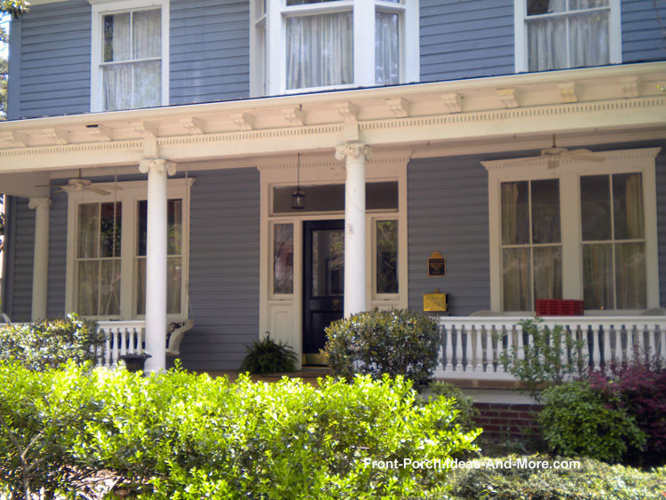Turned porch balusters on contemporary farm house porch