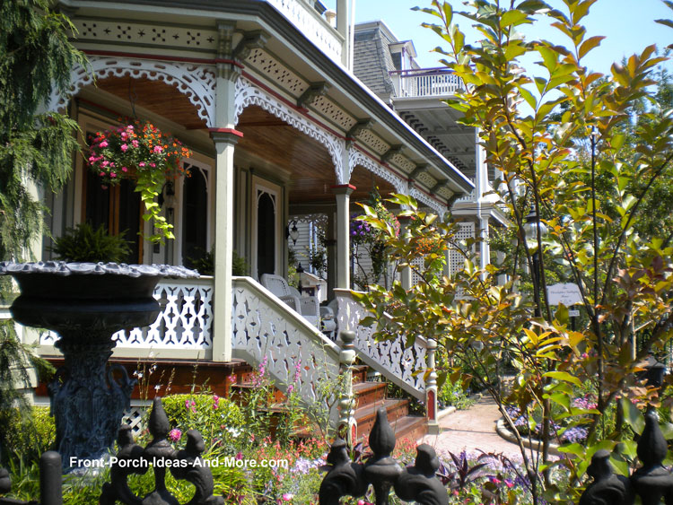exquisite Victorian front porch with landscaping