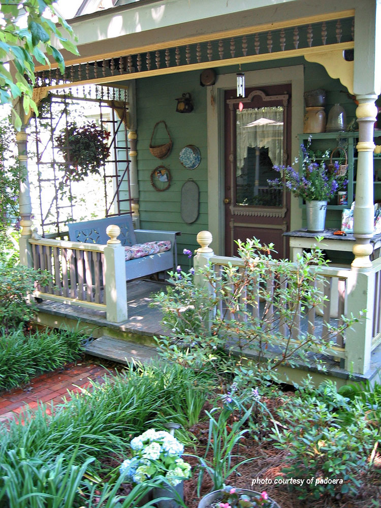 vintage metal porch glider on front porch from Amazon.com
