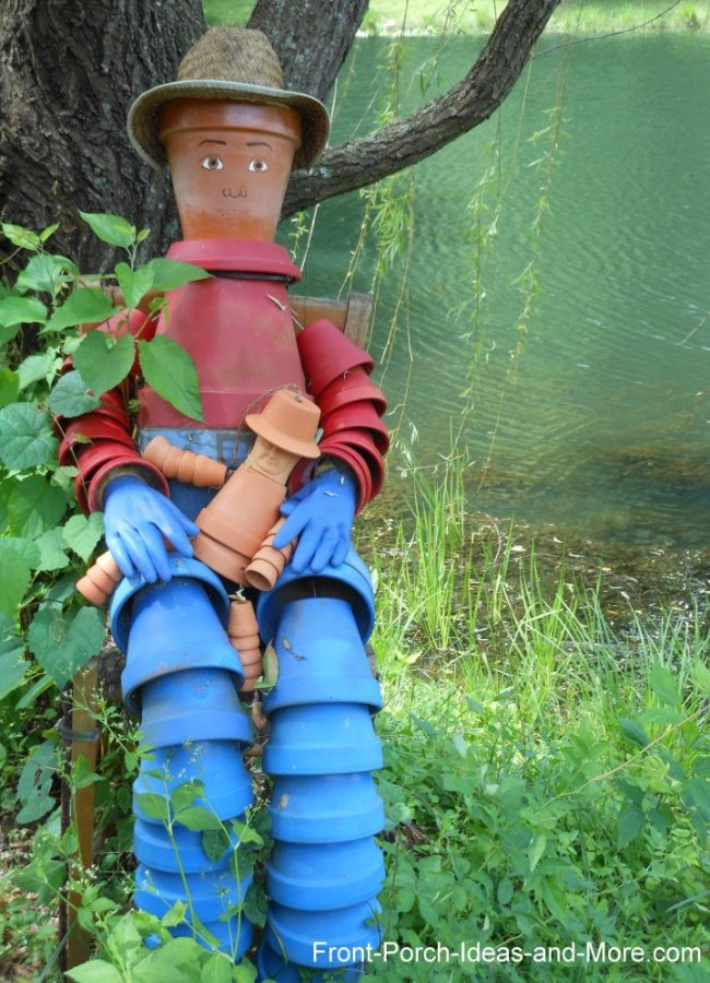 An adorable scarecrow made from clay pots