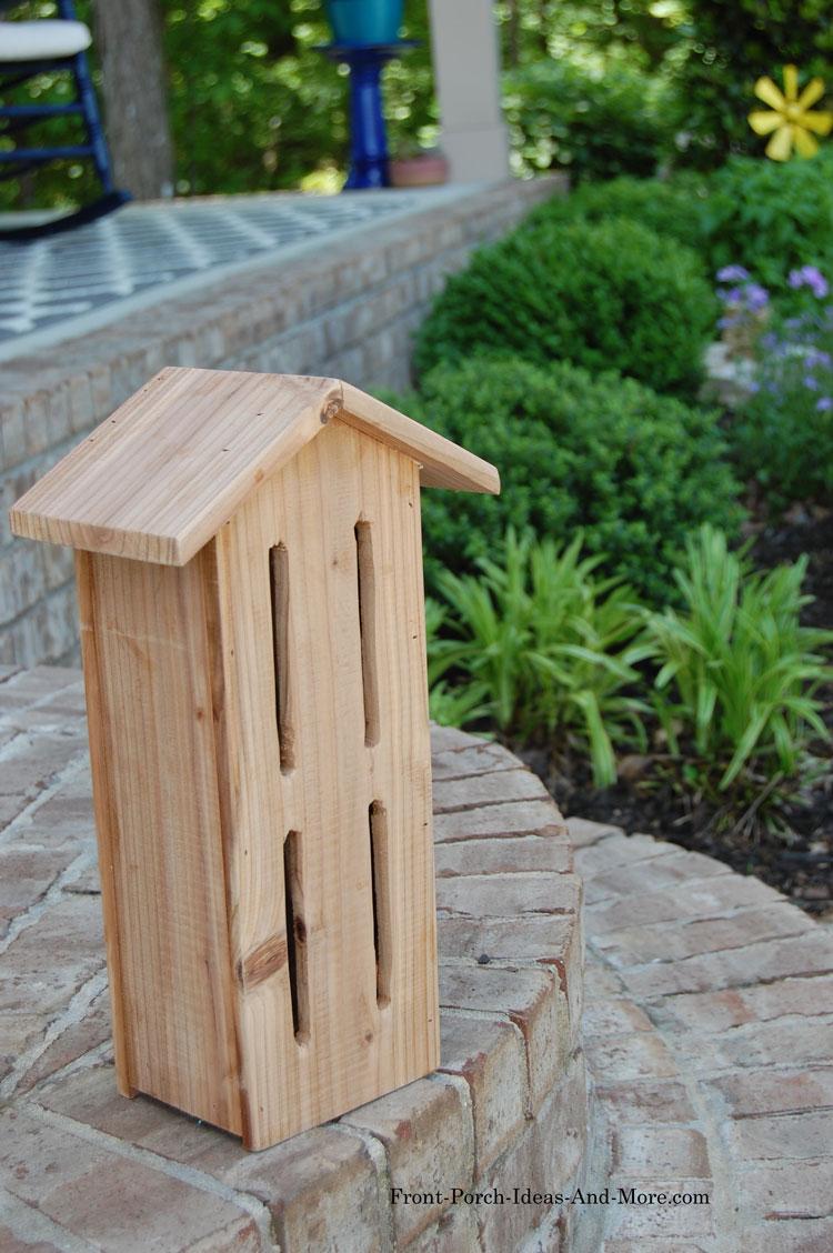 cedar butterfly house on front steps