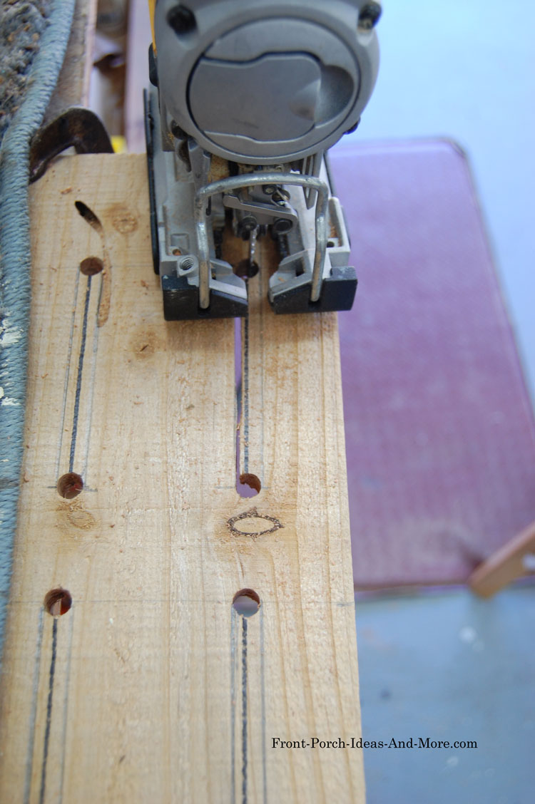 using jig saw to cut slots for butterfly house