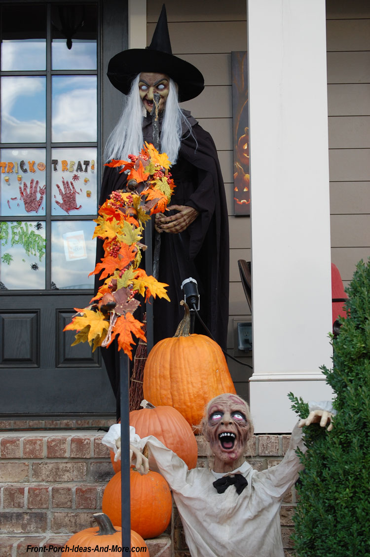 witch and zombie props on porch steps