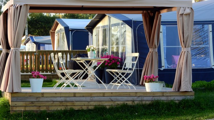 A freestanding porch is a wonderful idea if you have space for it