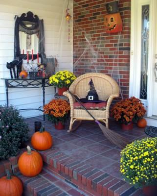 witch hat and broom on front porch