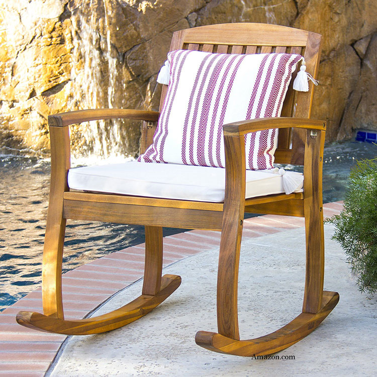 Acacia wood rocking chair with cushion on patio at Amazon.com