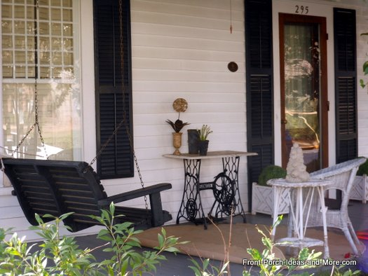 front porch swing and old sewing table