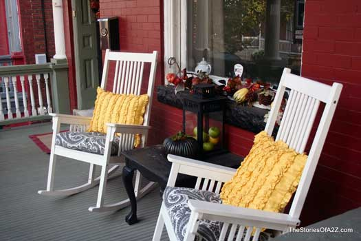 colorful fall cushions on Autumn Decorated Porch
