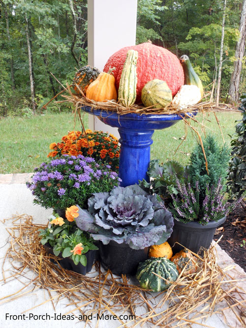 a birdbath decorated for autumn