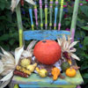 autumn gourds and pumpkins on colorful autumn chair