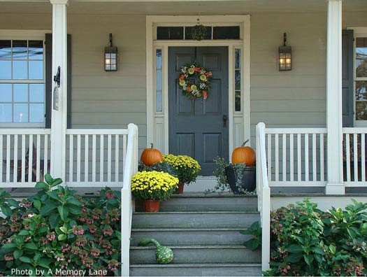 mums and pumpkins on front porch