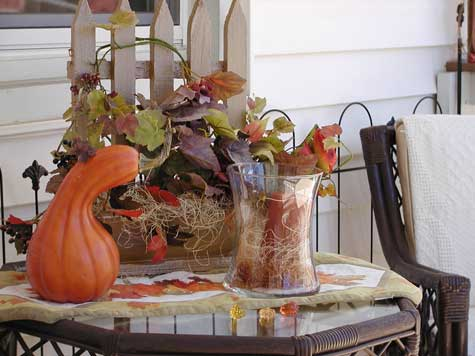 autumn decorated table with gourds