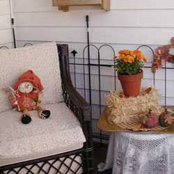 whimsical autumn decor on front porch
