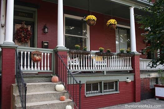 pumpkins lining the front porch steps
