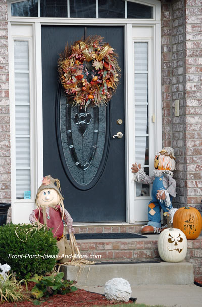 Whimsical fall decorations on the front porch