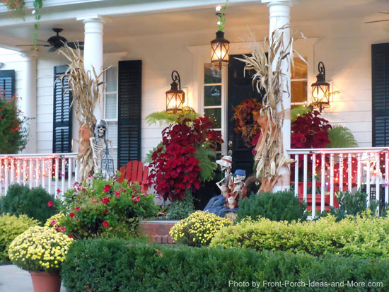 autumn harvest on front porch mixed in with Halloween skeletons