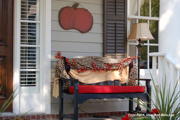 beautifully decorated porch bench for fall