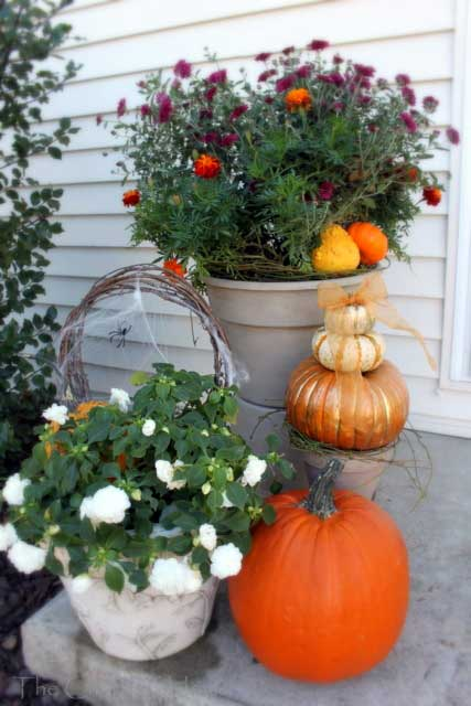 pumpkins and urns as fall decorations