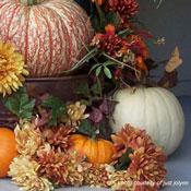 autumn pumpkin and mum decorations on front porch