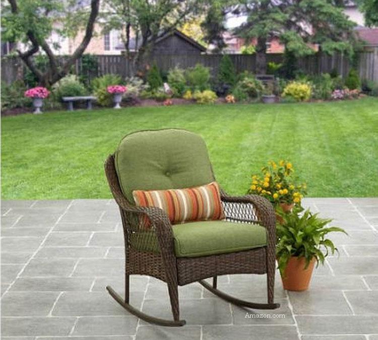 wicker rocking chair on stone patio