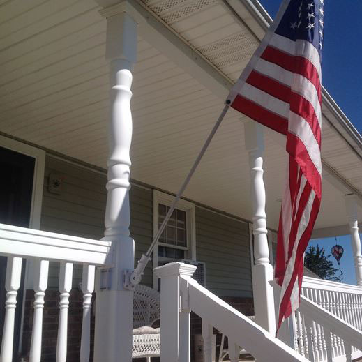 innovative flag or banner holder attached to front porch column