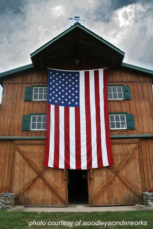 large American flag on beautiful barn