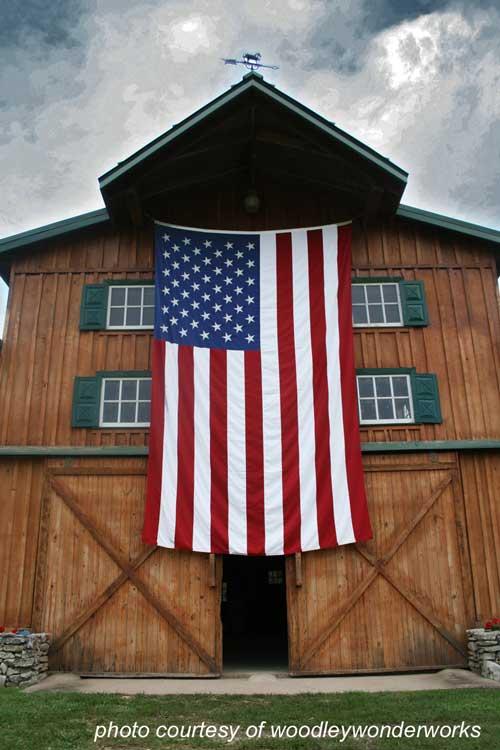 large American flag on beautiful barn