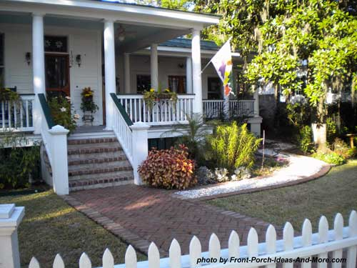 herringbone patterned brick walkway and front porch steps