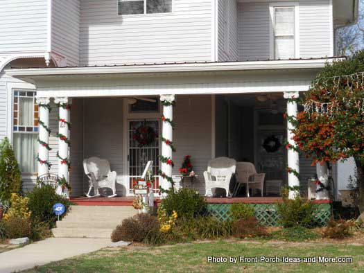 porch columns adorned with christmas garland