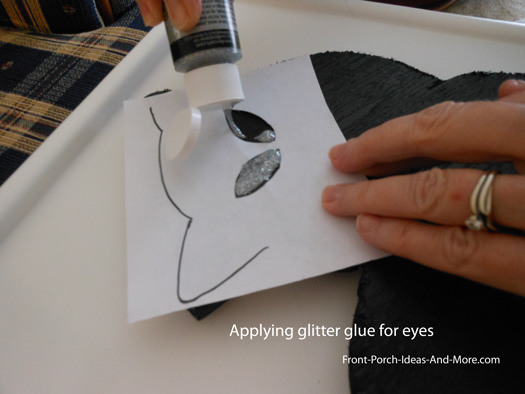 apply the eyes with glitter glue