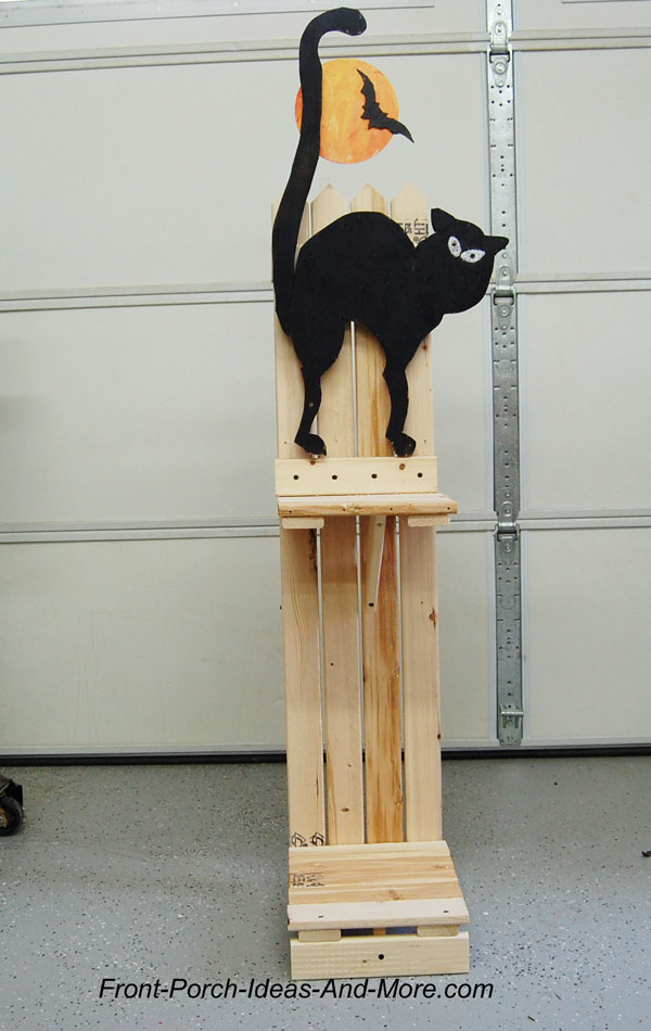 black cat on front porch halloween decorating idea candy holder