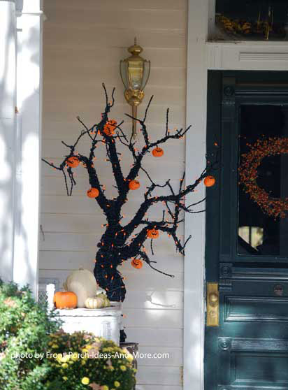 branches painted black and adorned with pumpkins for halloween