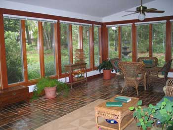 furnished and decorated sunroom addition