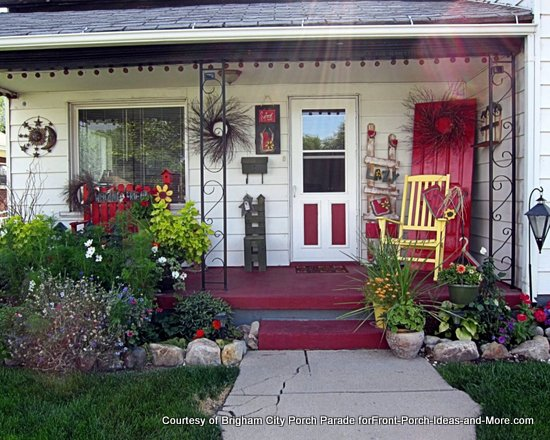 brigham city front porch decked out in red with yellow chair