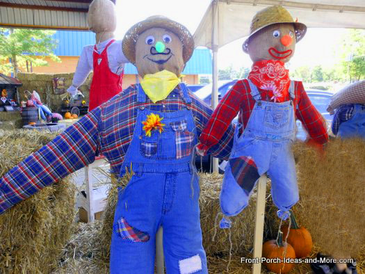 two adorable autumn decorating scarecrows
