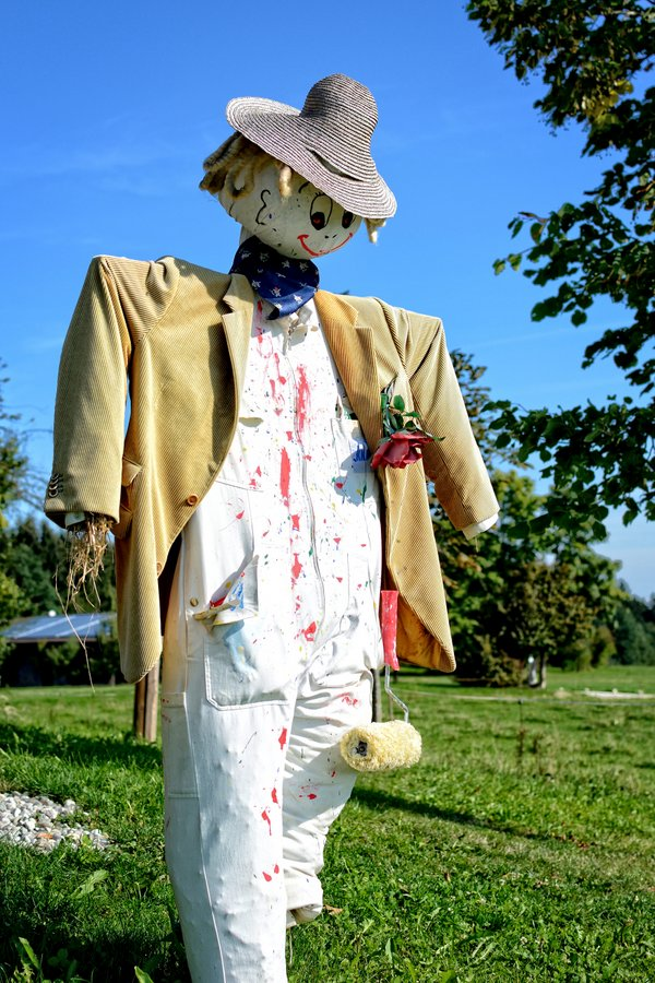 Happy painter scarecrow