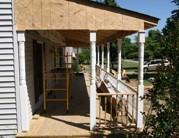 Installing supports. For this building a porch roof ... & Building a Porch Roof | Porch Roof Framing memphite.com
