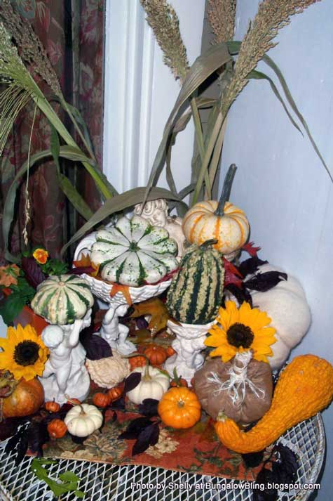 autumn gourds display on porch