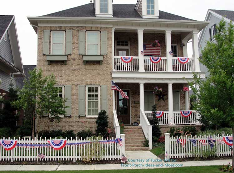 beautiful patriotic buntings on a picket fence