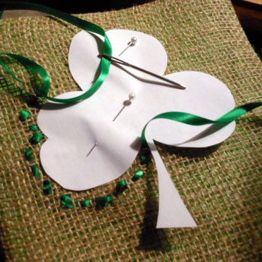 shamrocks painted on pillows for front porch